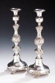 A PAIR OF MASSIVE SILVER CANDLESTICKS. Warsaw, 1887. On