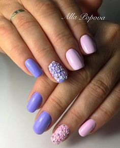 Bright and Bold Spring Flowers. Try this amazing nail art design that incorporates accent bold pink and blue flowers with the studs in middle. This neon amazing combination would definitely get some attention.