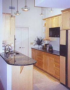 Sleekly sophisticated bird's eye maple kitchen cabinets