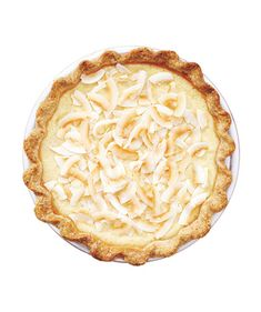 COCONUT CUSTARD PIE - Ingredients: 1 14oz can sweetened condensed milk - 1 13-oz can coconut milk - 3 large egg yolks - 1/4  tsp kosher salt - 9-inch basic flaky piecrust, parbaked - 1/4  cup  flaked or shredded coconut, toasted.  See link for directions.