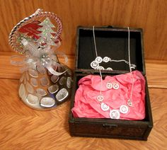 Sparkly silver jewelry set with silver bell ornament