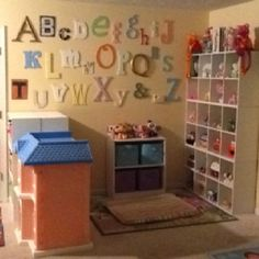 Love the alphabet wall! ~TGTFCC In home daycare Ducks in a Row Home Daycare Rooms, Daycare Spaces, Childcare Rooms, Daycare Crafts, Daycare Setup, Daycare Organization, Daycare Ideas, Daycare Design, Alphabet Wall