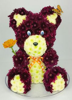 Teddy bear made of fresh flowers.