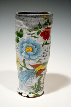 I want everything this guy makes :)Earthenware vase with colorful flowers by rothshank on Etsy, $90.00