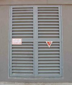 Could be a cost effective 'shutter' solution that is strong, cheap, maintenance free. For entrance door or over the bathroom window (so people can't look in). Could be painted any colour. Entrance Doors, Garage Doors, Bathroom Windows, Types Of Doors, Door Design, Shutters, Metal Doors, How To Plan, Steel