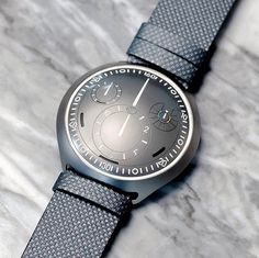 THIS WATCH IS THE FUTURE. Whilst smartwatch makers were battling it out at CES (showing us the same predictable smartwatches with yet another designer label) over in Geneva @ressence_watches showed off what I feel could be the future of hybrid mechanical/electronic watches. Powered by both wrist movement and a series of photovoltaic cells the Ressence Type 2 e-Crown Concept Watch straddles the line between connected and traditional timepiece. It has three operating modes: full e-Crown in…