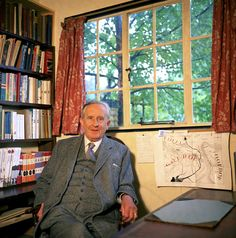 Everyone's favorite professor...    J.R.R. Tolkien in his study with his maps and books.