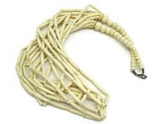 A wonderful vintage carved bone multi strand statement necklace. It has eight strands of long beads.  No marks. Measures about 31.5 long. Some
