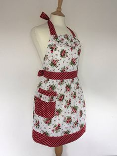 Retro apron with ruffles vintage red floral pattern. 1950s