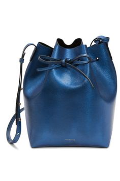The Mansur Gavriel bag for Colette - the cult favorite handbags are taking over a window at Colette during Paris Couture Week with an exclusive version of their best-selling bucket bag in metallic blue saffiano leather with a pony hair print. [Photo: Courtesy]