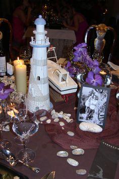 Faro y barco en mesa presidencial marinera. Boda Juan y María. Salones Carrasco