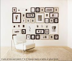 The Picture Wall Company sells sets of frames (chose your finish) along with grids for marking out where to hang each one on the wall.  You simply print the photos at the size to fit each frame and VOILA! You can use multiple sets, change the layout to go up stairs walls and so on.