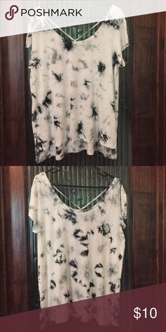 American Eagle Short Sleeve Tie Dye Shirt American Eagle Outfitters tie dye short sleeve shirt with front cross straps. Only worn once. Smoke free home. American Eagle Outfitters Tops Tees - Short Sleeve
