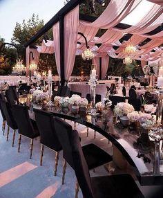 Such a beautiful outdoor setup! Stunning! #munaluchibride #munaluchibridal #outdoordecor ____ Draping and furnishings: @revelryeventdesign Floral: @hiddengardenflowers Lighting: @lightenup_inc Rentals: @arentalconnection Catering: @thekitchenforexploringfoods