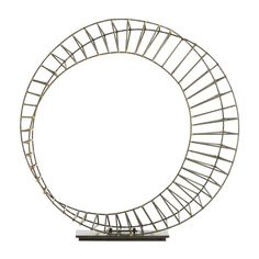 This wheel-like sculpture is hand made of thin natural iron welded together with brass. It is then mounted on a natural iron rectangular base. A great sculpture for a console or credenza.  http://www.livingonmaindbq.com/store/p222/Neo_Sculpture.html