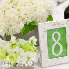 The table numbers were framed in distressed wooden, white frames. (A great alternative to the typical table number!)