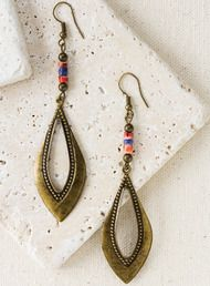 The bronze teardrop earrings, topped with red oyster shell and sodalite beads; French wires.