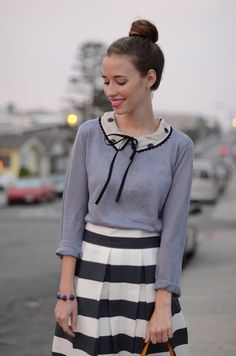 Polka dot Peter Pan collar, grey sweater, and striped skirt.