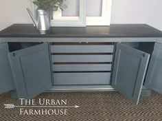 This stunning high quality Kindel buffet/credenza. The body has been painted in a masculine deep blue gray using Annie Sloan graphite/aubusson blue chalk paint mix and topped with dark wax. The top has been handpainted in graphite and also topped with a dark wax to give it dimension and a velvety smooth finish.