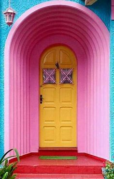 Stunning Pink archway and yellow door entrance in Brazil
