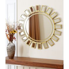 Add a cheerful burst of style to any room in your home with this whimsical Sunburst round mirror. Featuring thin golden borders for a chic effect, this simple mirror features a sunshine motif to brighten your home decor.