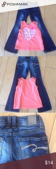 Justice Girls Jeans & Tank Bundle Cute outfit!  Jeans are gently worn but in good shape.  No rips, tears or stains on either item.  Tank is by Poof Girl, also in good shape.  You get both for one price! Justice Matching Sets