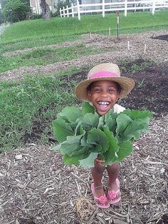 SHOW ME THE GREEN: Second-grader Tendekai Wainwright loves helping her mom, Nyarai Franklin, at their Olathe, Kansas community garden plot.