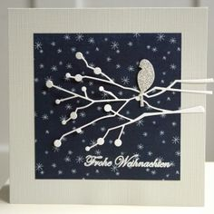 handmade Winter card ... navy printed paper with tiny snowflakes all over ... white die cut berry branches with a silver glitter paper bird ... wonderful card ...