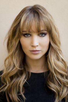 Bangs, long hair, loose waves.  Jennifer Lawrence.