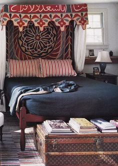 Calligraphy Textile as bed canopy, LV Louis Vuitton trunk in global bedroom