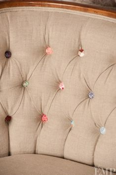 I like the contrast of the neutral linen with the colored buttons.  DIY Covered Button Crafts and decorating ideas