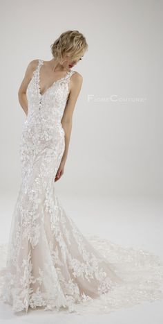 Romantic as can be with this floral beauty by the name of Violet. Not only can you find delicate lace details on with wedding gown but a stunning sparkle as well. The trumpet silhouette is here to highlight your curves. If you love this gown click the link for more info. #weddingideas #weddingdresses #weddinggown #weddingplans #brideinspo #bridestyle Wedding Dress Train, Dream Wedding Dresses, Wedding Gowns, Bridesmaids, Bridesmaid Dresses, Welcome To Our Wedding, Mermaid Gown, Dress Silhouette, Couture Collection