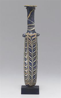 AN EASTERN MEDITERRANEAN CORE-FORMED GLASS ALABASTRON  CIRCA MID 2ND-EARLY 1ST CENTURY B.C.