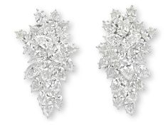 A PAIR OF DIAMOND EAR CLIPS, BY HARRY WINSTON   Each designed as an articulated pear-shaped diamond cluster, mounted in platinum  Signed HW for Harry Winston, no. 63497
