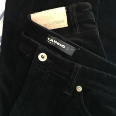 """Crazy Comfortable Cambio Jeans Cambio is Oprah's no. 1 jeans company for all body types. Black velvet jeans are 98 percent cotton, 2 percent Elastane for ease of fit and movement. 42 inches from top of waist to end of pant leg: 30-inch inseam. 9"""" leg opening; slight flare. Cambio Pants Boot Cut & Flare"""
