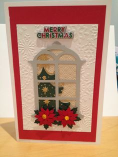 Cricut Christmas card. With embossing folder and poinsettia stickers.