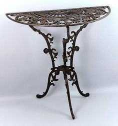 Brown Cast Iron Half Moon Table