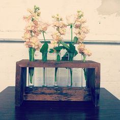 We are obsessed with this reclaimed wood and test tube vases from @Bad_inc! They were in the market last week, and they'll be in this week too!  #madeinla