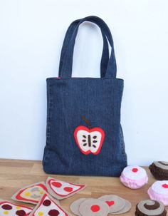 This DIY tote bag is no different. If you are looking for something absolutely cute to sew up, you should absolutely make this easy sewing pattern designed especially for toddlers! The Denim Toddler Tote is a tiny tote made out of old jeans that will help your little one play grown up all day long