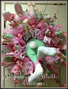 Bunny butt spring wreath with deco mesh and burlap with floral accents.  By Twentycoats Wreath Creations (2016)