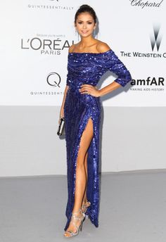 We're green with envy over this shoulder-baring royal blue Elie Saab gown with a super high slit that Nina wore to amfAR's 2011 Cinema Against AIDS Gala. The actress finished off her amazing look with silver strappy Jimmy Choo Lance sandals, Bulgari jewels, a sultry smoky eye, and high bun that allowed the focus to stay on her dress.