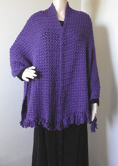 Beautiful purple fringe fashion shawl and wrap can be used as a scarf and cover for your head. Colorful and inviting! This item is extra wide and long to keep you warm and is a great clothing accessory for your wardrobe to use for night or day. All handmade with crochet fringes instead of strings. Measures approximately 21 inches wide by 76 inches long. Designed by Robin Harley. FREE SHIPPING IN THE U.S.