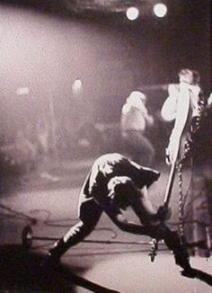 """This Clash 1978 classic """"London Calling"""" image is one of the most recognised album covers of all time. The bass Simonon regretfully smashed during this concert was a White Fender Precision Bass with a distinctive black pick-guard with paint-mes"""