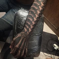 These are amazing tattoos that blow you away. These aren't little pieces of flash, these are show-stopping tattoos that will make your jaw drop and wonder what great heights tattoo art can reach. Hai Tattoos, Bone Tattoos, Skull Tattoos, Black Tattoos, Body Art Tattoos, Tatoos, Bone Hand Tattoo, Arm Tattoo, Biomech Tattoo