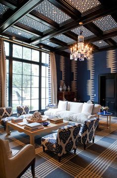 super hot coffered ceilings with either paper or textiles as accent...not sure...