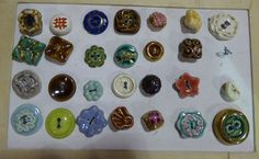 Card of ceramic buttons.