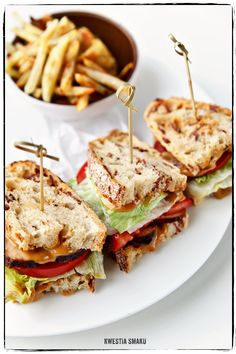 Club Sandwich with homemade rustic bread with bacon