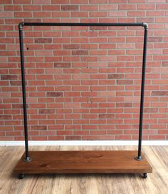 "William Roberts Vintage Industrial Style Clothing Rack This Rustic Vintage Clothing Rack is made to last forever. Using up-cycled 3/4 black pipe and 3/4 Iron pipe fittings accompanied by 1-1/2 think rustic Cedar wood, this heavy duty clothing rack will last a lifetime. Our clothing racks are great for use in retail stores or for extra storage in your home. Features:  ¾"" Black Pipe and Fittings  1-1/2 Cedar Wood  Heavy Duty Design  Storable  Rustic Vintage Look  Mad..."