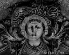 Shot in black and white, detail on an sculpture representing a female figure placed on the facade of this historic building, set in Eixample, Barcelona, Catalunya, Catalonia, España, Spain, Europa, Europe