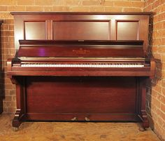 A 1906, Steinway Model K vertegrand upright piano with a rosewood case at Besbrode Pianos. £7000